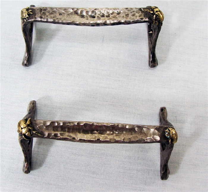 Tiffany knife rest with applied metal Bugs